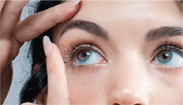 close up of woman inserting contact lens